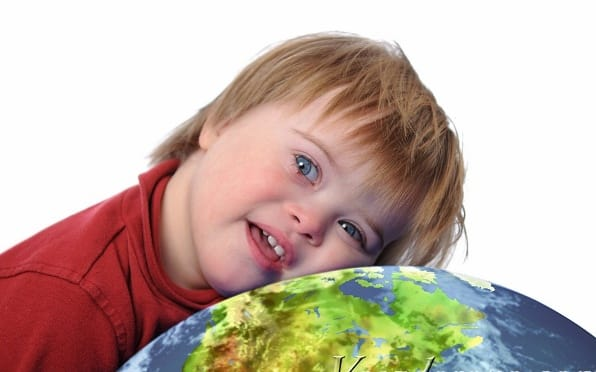 Boy with down syndrome and earth isolated on white
